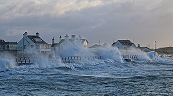 large-waves-on-shore-breaking-over-metal-fencing.jpg